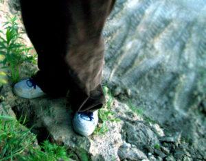 feet standing on rock